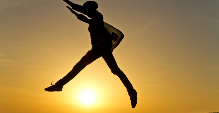 Person jumping in front of sunset