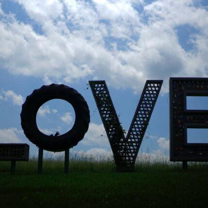 "Photo of sculpture spelling ""love"""