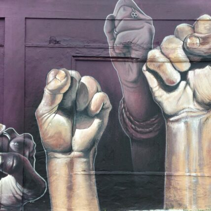 Photo of mural depicting raised fists