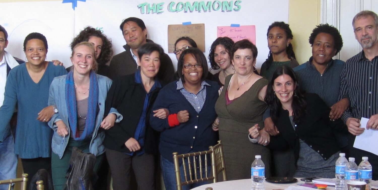 Photo of NLIL group with linked arms