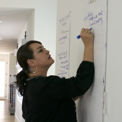 Aja Couchis Dennis writing on a white board