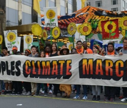 People's Climate March in NYC - people holding big banner