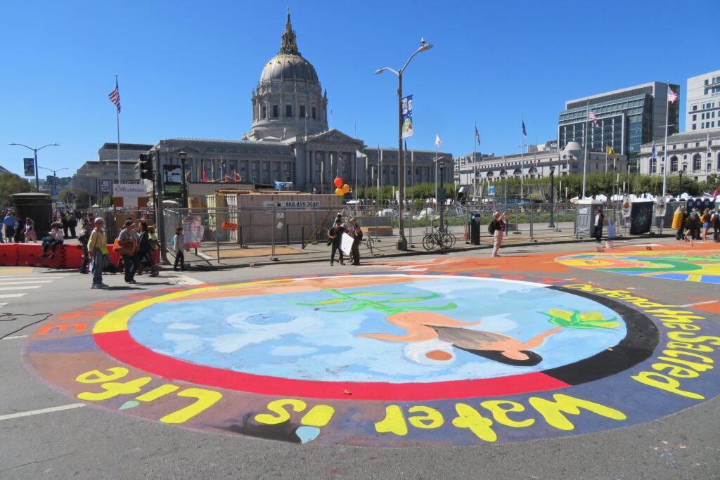 Water is Life mural on the ground in San Francisco