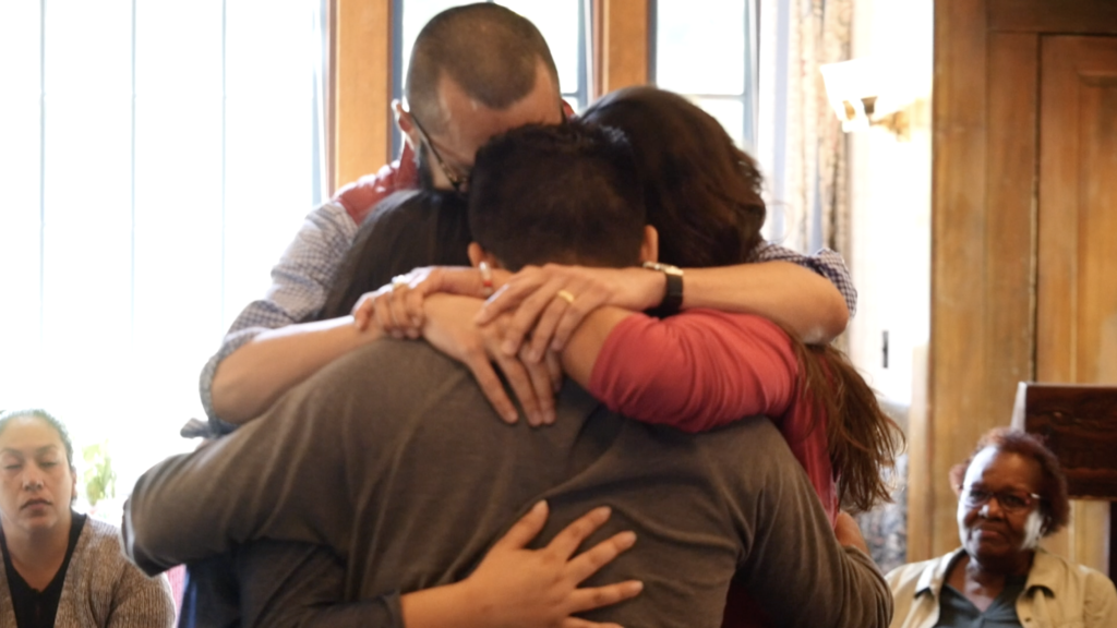 image of three people hugging