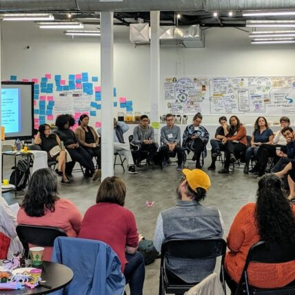 Photo of convening participants sitting in a circle